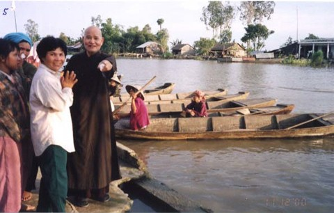 Thich Quang Do leads a UBCV relief mission to aid flood victims in the mekong delta