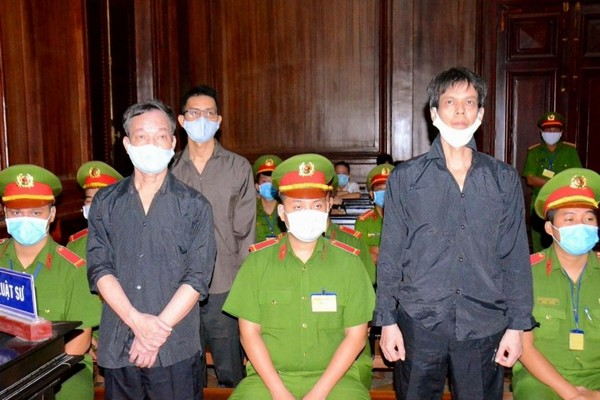 From left to right: Nguyễn Tường Thụy, Lê Hữu Minh Tuấn and Phạm Chí Dũng at their trial in Ho Chi Minh City on 5 January 2021 (Photo AFP)